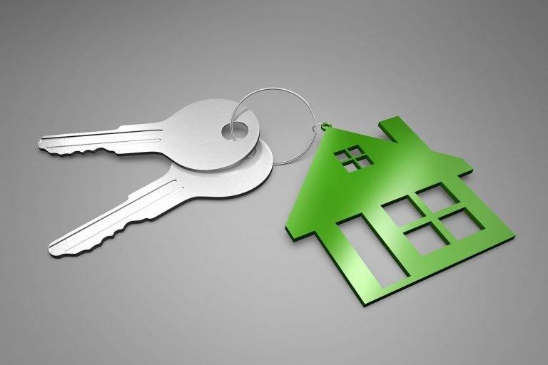 Two keys and a housecharm on a key chain