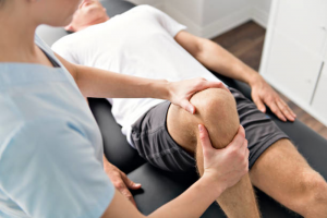 Physical Therapist Stretching a patient's leg